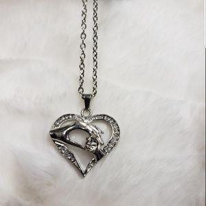 Heart and hands necklace. NEW